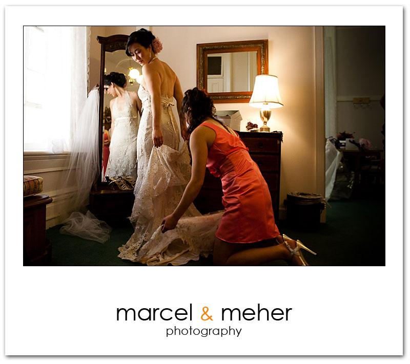 Bride getting ready at Ralston Hall, elegant wedding dress